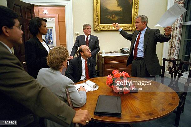 President Geroge W. Bush speaks to his staff inside the private dinning room September 11, 200 at The White House prior to his address to the nation...