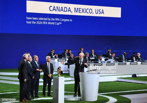TOPSHOT FIFA president Gianni Infantino addresses the United 2026 bid officials Carlos Cordeiro president of the United States Football Association...