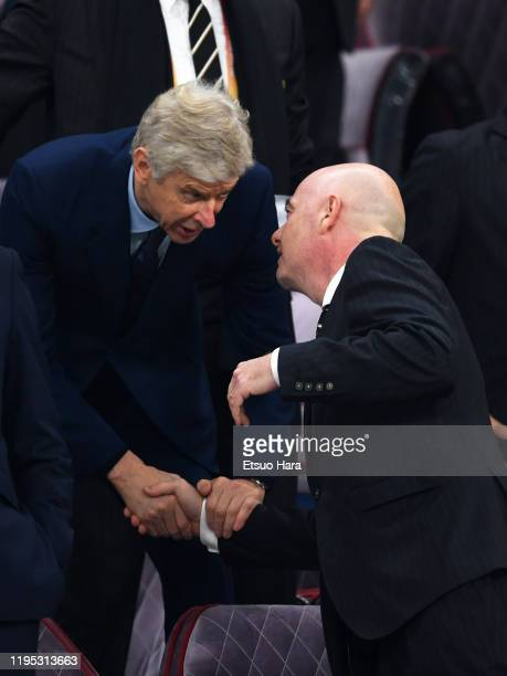 President Gianni Infantino and Arsene Wenger shake hands prior to the FIFA Club World Cup Final between Liverpool and Flamengo at Khalifa...