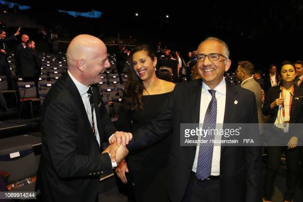 FIFA president Gianni Infantino and Carli Lloyd of the United States laugh with Carlos Cordeiro President of the US Soccer Federation following the...