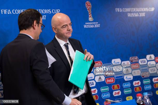 President Gianni Infantino and FIFA Head of Communication Fabrice Jouhaud leave after the final press conference of FIFA at the World Cup Arena in...