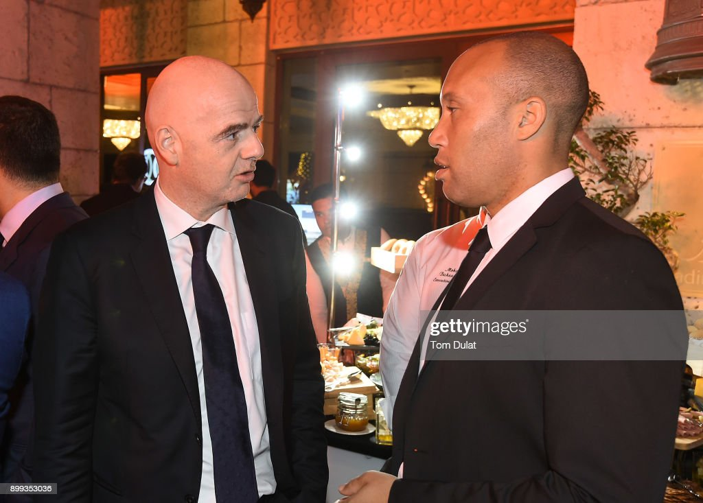 President, Gianni Infantino and Mikael Silvestre chat during the Globe Soccer Awards 2017 on December 28, 2017 in Dubai, United Arab Emirates.