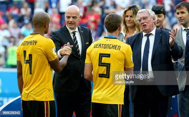 President Gianni Infantino and President of Royal Belgian Football Association Gerard Linard give medals to Vincent Kompany Jan Vertonghen of Belgium...