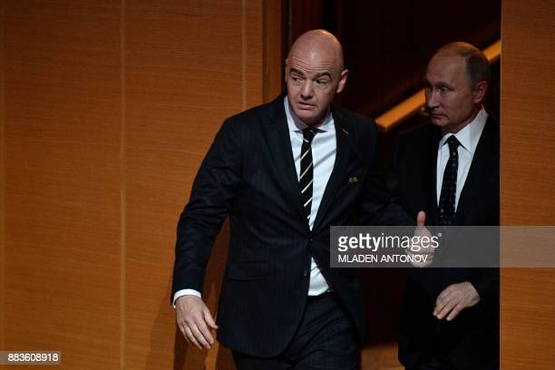 FIFA president Gianni Infantino and Russian President Vladimir Putin enter the stage prior to the Final Draw for the 2018 FIFA World Cup football...