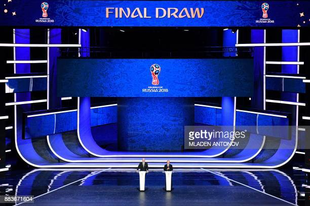TOPSHOT FIFA president Gianni Infantino and Russian President Vladimir Putin speak on stage ahead of the Final Draw for the 2018 FIFA World Cup...