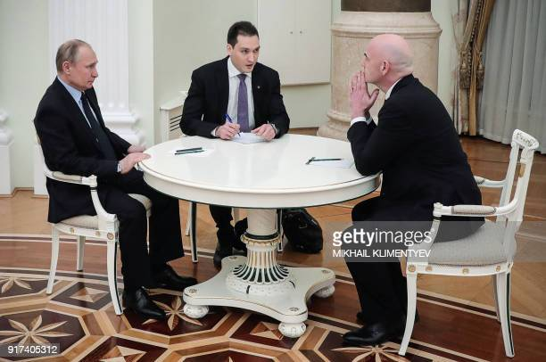 FIFA president Gianni Infantino and Russian President Vladimir Putin talk during their meeting in the Kremlin in Moscow on February 12 2018 / AFP...