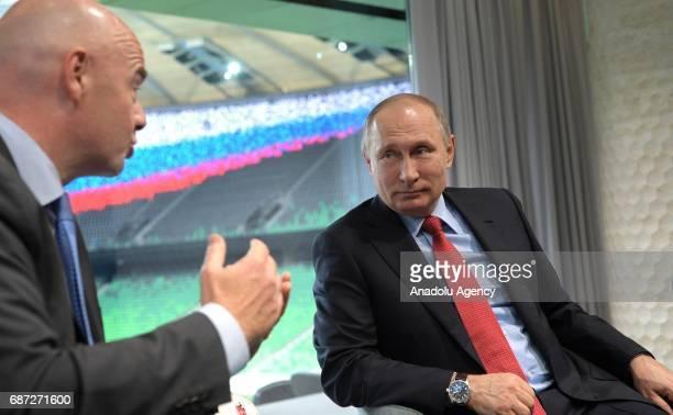 FIFA President Gianni Infantino and Russia's President Vladimir Putin talk each other as they visit FC Krasnodar Stadium in Krasnodar Russia on May...