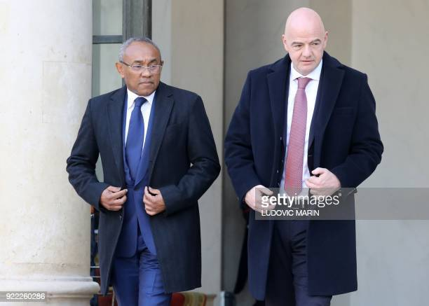 President Gianni Infantino and the Confederation of African Football President Ahmad Ahmad leave after a meeting with the Liberian and the French...