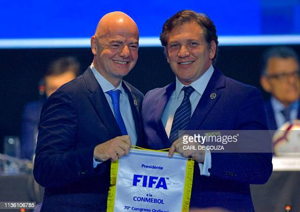 President Gianni Infantino and the President of the South American Football Confederation Alejandro Dominguez pose during the 70th Ordinary Congress...