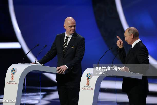 President Gianni Infantino and Vladimir Putin President of Russia speaks to the crowd during the Final Draw for the 2018 FIFA World Cup Russia at the...