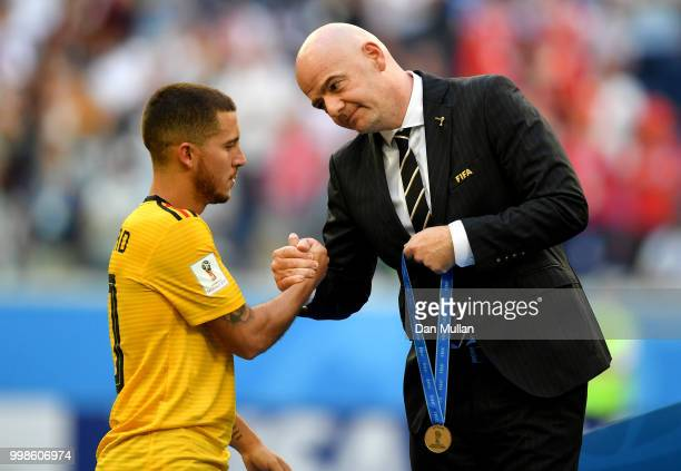 President Gianni Infantino awards Eden Hazard of Belgium with his third place medal after the 2018 FIFA World Cup Russia 3rd Place Playoff match...