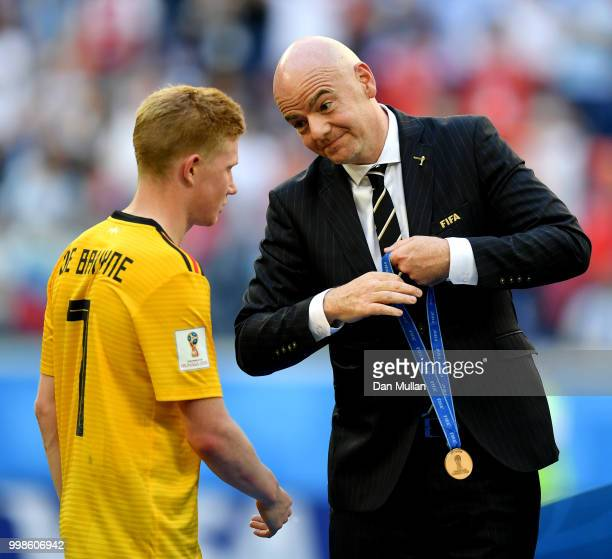 President Gianni Infantino awards Kevin De Bruyne of Belgium with his third place medal after the 2018 FIFA World Cup Russia 3rd Place Playoff match...