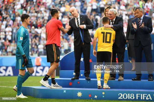 President, Gianni Infantino, awards Nacer Chadli of Belgium with his third place medal after the 2018 FIFA World Cup Russia 3rd Place Playoff match...