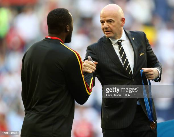 President Gianni Infantino awards Romelu Lukaku of Belgium with his third place medal after the 2018 FIFA World Cup Russia 3rd Place Playoff match...
