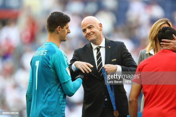 President Gianni Infantino awards Thibaut Courtois of Belgium with his third place medal after the 2018 FIFA World Cup Russia 3rd Place Playoff match...