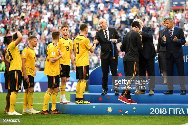 President Gianni Infantino awards Thomas Vermaelen of Belgium with his third place medal after the 2018 FIFA World Cup Russia 3rd Place Playoff match...