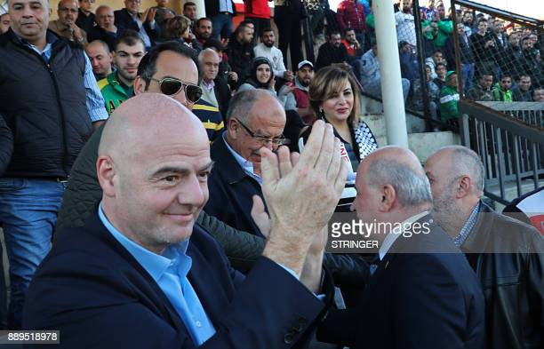 President Gianni Infantino claps as he watches Lebanon's alAnsar football team play al Shabab alAraby in Beirut on December 9 2017 / AFP PHOTO /...