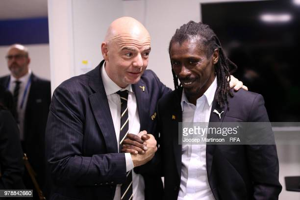 FIFA president Gianni Infantino congratulates Aliou Cisse Head coach of Senegal following the 2018 FIFA World Cup Russia group H match between Poland...