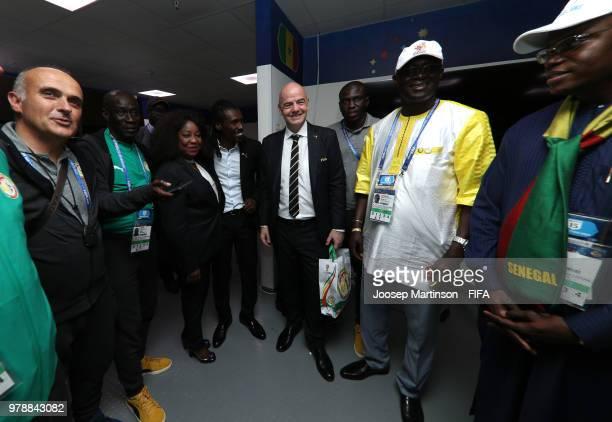 FIFA president Gianni Infantino congratulates Aliou Cisse Head coach of Senegal following the 2018 FIFA World Cup Russia group H match between Poland...