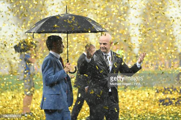 President Gianni Infantino gestures about the rain during the 2018 FIFA World Cup Russia Final between France and Croatia at Luzhniki Stadium on July...