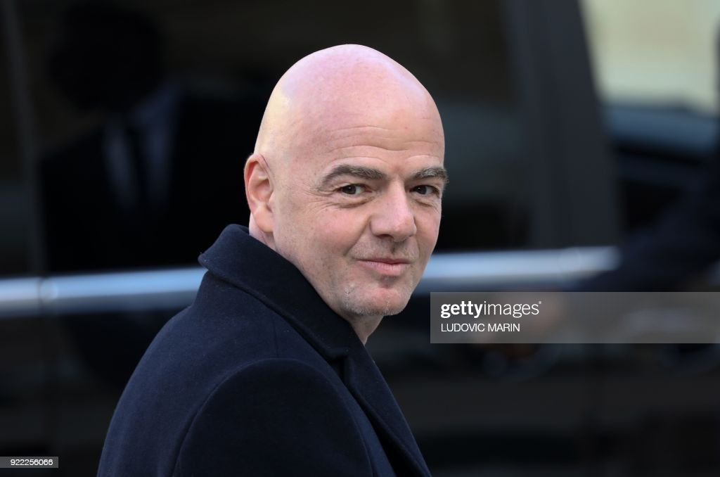 President Gianni Infantino gestures as he leaves at The Elysee Palace in Paris on February 21, 2018, after attending a lunch function given for Liberian President George Weah. /