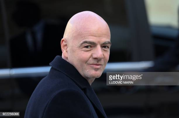 President Gianni Infantino gestures as he leaves at The Elysee Palace in Paris on February 21 after attending a lunch function given for Liberian...