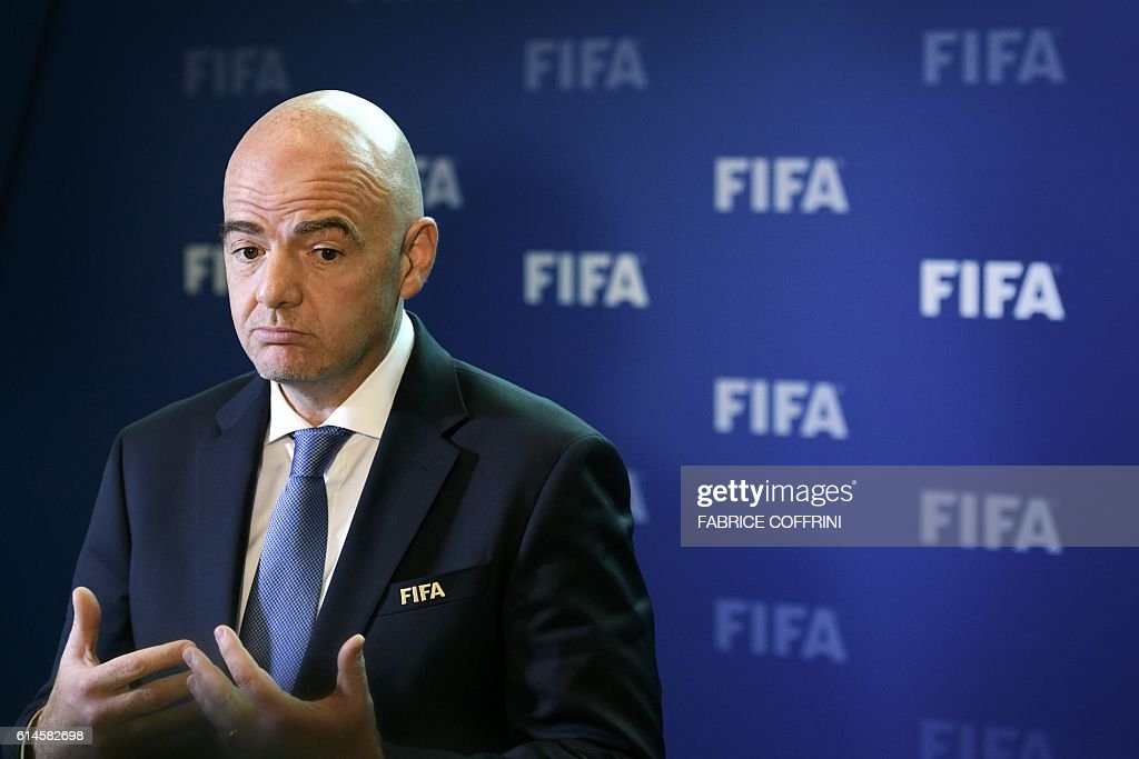 FIFA president Gianni Infantino gestures as he speaks after a meeting of the FIFA Council on October 14, 2016 at the world football's governing body headquarters in Zurich. FIFA executives will make a final decision on World Cup reform in January after weighing up three proposals on October 13, as president Gianni Infantino pushes plans to grow the lucrative tournament. / AFP / FABRICE