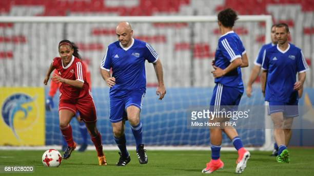 President Gianni Infantino gets away from England International Alex Scott during the FIFA Football Tournament at the Bahrain National Stadium ahead...