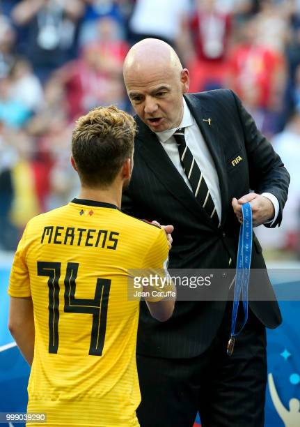 President Gianni Infantino gives a medal to Dries Mertens of Belgium during the medal ceremony for 3rd place following the 2018 FIFA World Cup Russia...
