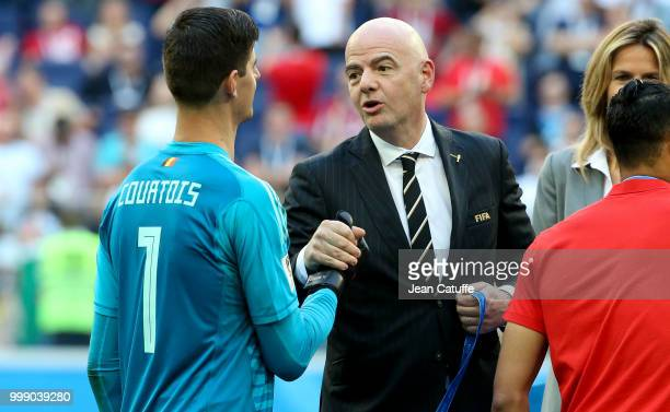 President Gianni Infantino gives a medal to goalkeeper of Belgium Thibaut Courtois during the medal ceremony for 3rd place following the 2018 FIFA...