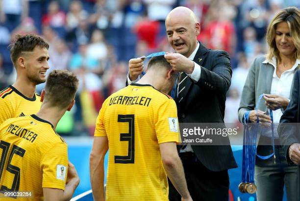 President Gianni Infantino gives a medal to Thomas Vermaelen of Belgium during the medal ceremony for 3rd place following the 2018 FIFA World Cup...