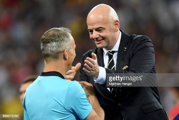 FIFA president Gianni Infantino greets Fourth official Bjorn Kuipers during presentations after the 2018 FIFA World Cup Final between France and...