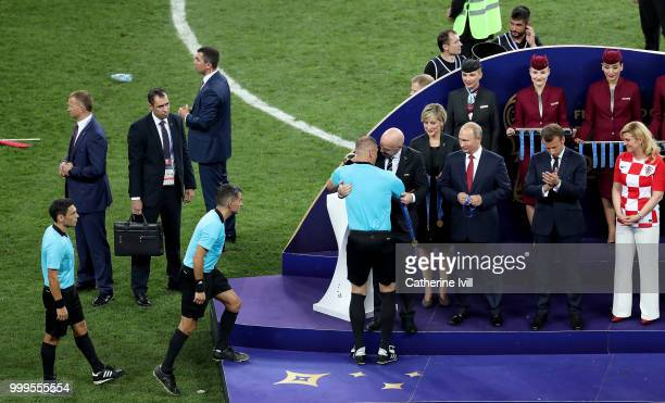 President Gianni Infantino greets Referee Nestor Pitana on the podium following the 2018 FIFA World Cup Final between France and Croatia at Luzhniki...