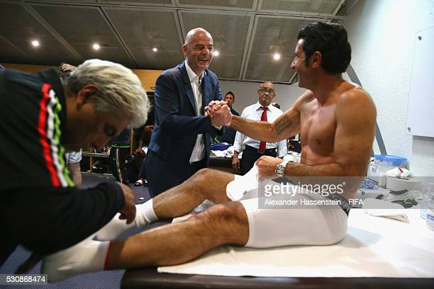 President Gianni Infantino jokes with Luis Figo at the dressing room prior to an exhibition match between FIFA Legends and MexicanAllstars to...