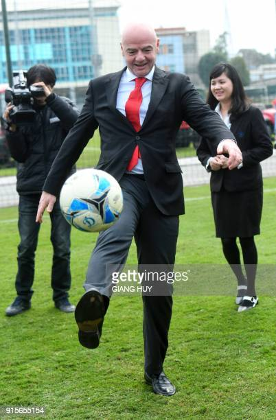 FIFA president Gianni Infantino kicks a football in front of the media during a visit to the Vietnam Football Federation in Hanoi on February 8 2018...