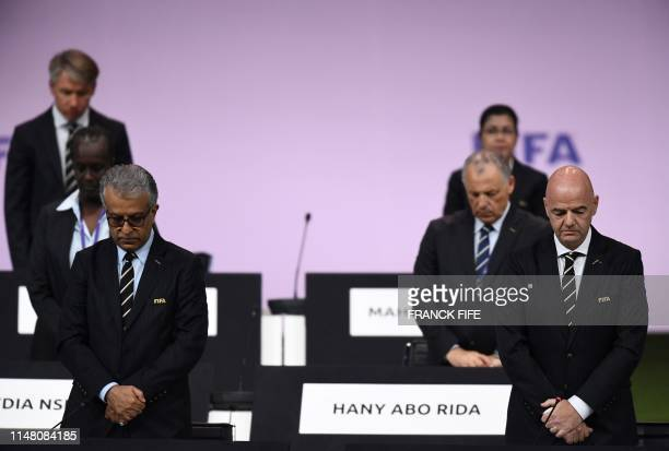 President Gianni Infantino leads delegates as they observe silence at the 69th FIFA Congress at Paris Expo Porte de Versailles in Paris on June 5...