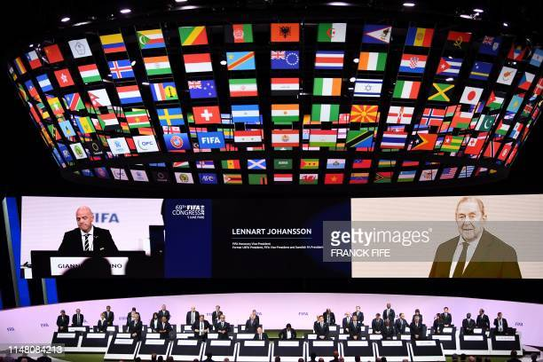 President Gianni Infantino leads delegates as they rise to observe silence at the 69th FIFA Congress at Paris Expo Porte de Versailles in Paris on...