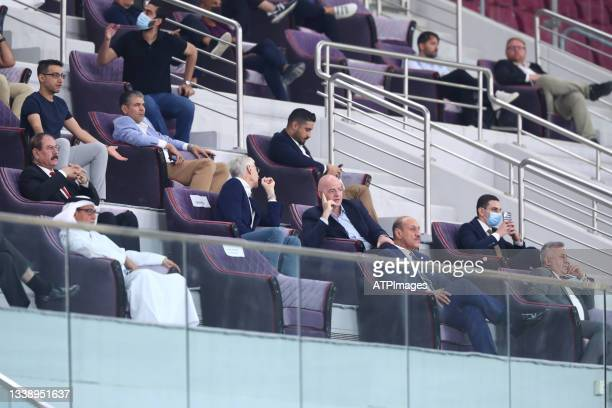 President Gianni Infantino listens to FIFA's Chief of Global Football Development Arsene Wenger during FIFA World Cup Qatar 2022, Asia Qualifier...