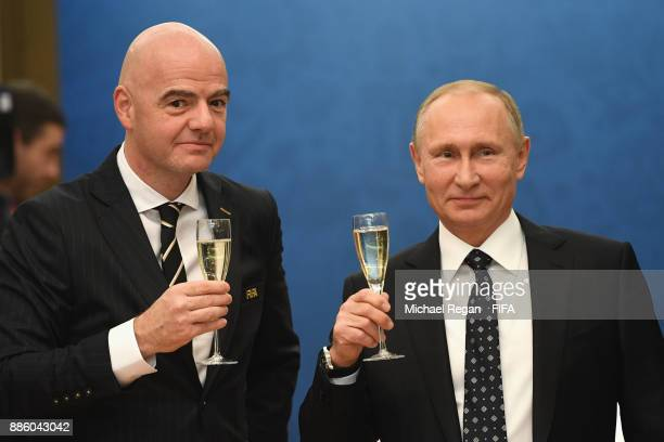 President Gianni Infantino looks on with Vladimir Putin President of Russia prior to the Final Draw for the 2018 FIFA World Cup Russia at the State...