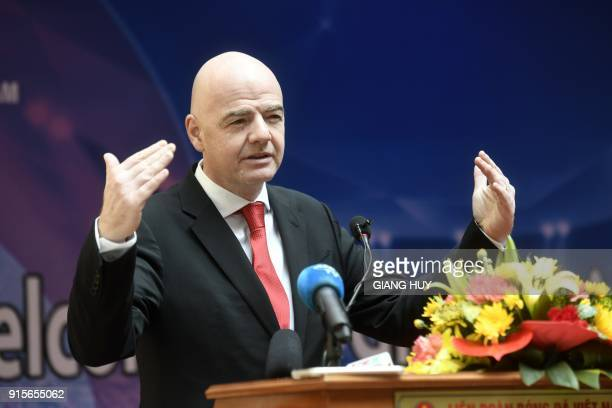 FIFA president Gianni Infantino makes a speech during a visit to the Vietnam Football Federation in Hanoi on February 8 2018 Infantino on February 8...