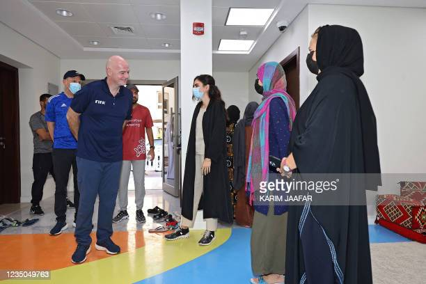 President Gianni Infantino meets with Afghan refugee at their place of accommodation at Park View Villas, a Qatar's 2022 FIFA World Cup residence in...