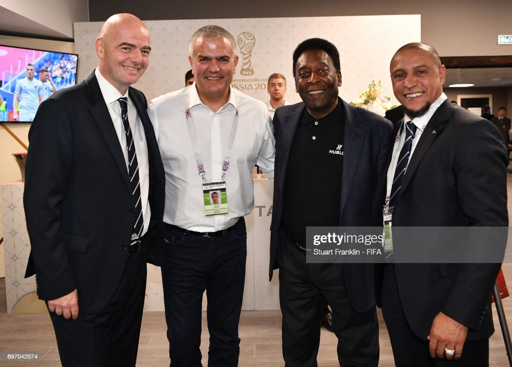 FIFA president Gianni Infantino meets with Brazilian football legends Pele and Roberto Carlos prior to the FIFA Confederations Cup Group A match between Russia and New Zealand at Saint Petersburg Stadium on June 17, 2017 in Saint Petersburg, Russia.
