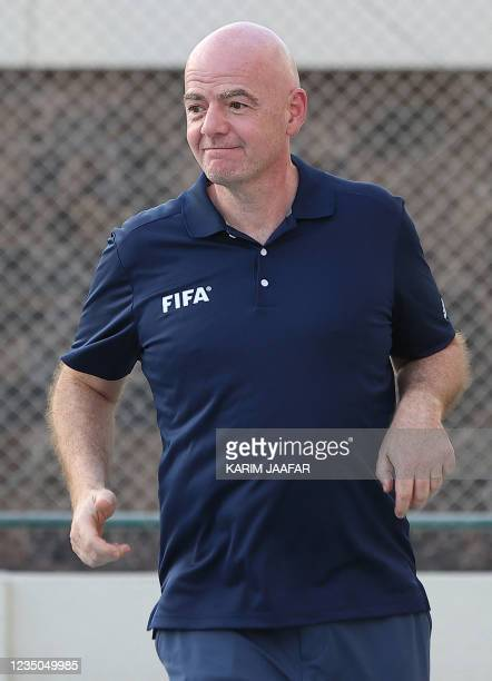 President Gianni Infantino plays football with Afghan refugees at their place of accommodation at Park View Villas, a Qatar's 2022 FIFA World Cup...