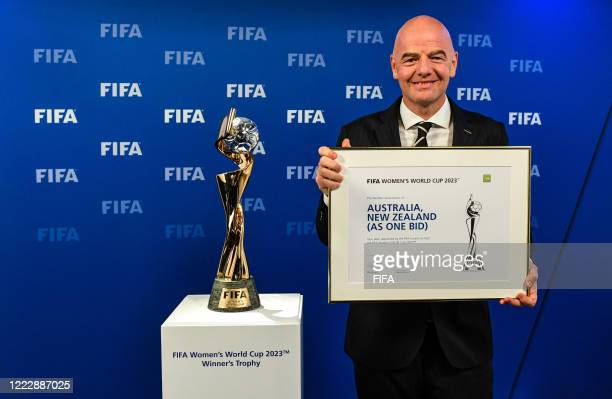 President Gianni Infantino pose with the Women's World Cup Trophy after the announcement that Australia/New-Zealand are the winning host's for the...