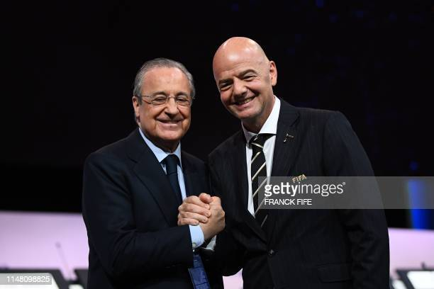 President Gianni Infantino poses for a picture with Real Madrid's president Florentino Perez after being reelected by acclamation for a second term...
