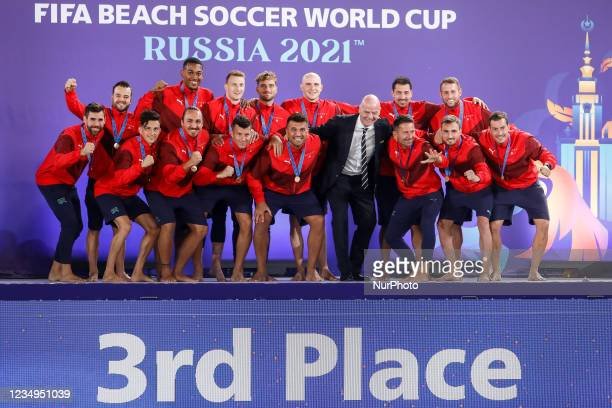 President Gianni Infantino poses with Switzerland team who celebrate finishing in third place during the prize-giving ceremony of the FIFA Beach...
