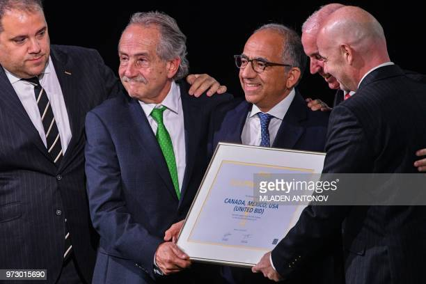 FIFA president Gianni Infantino poses with the United 2026 bid officials Carlos Cordeiro president of the United States Football Association...