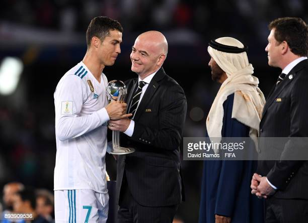 FIFA president Gianni Infantino presents Cristiano Ronaldo of Real Madrid with the trophy after the FIFA Club World Cup UAE 2017 Final between Gremio...