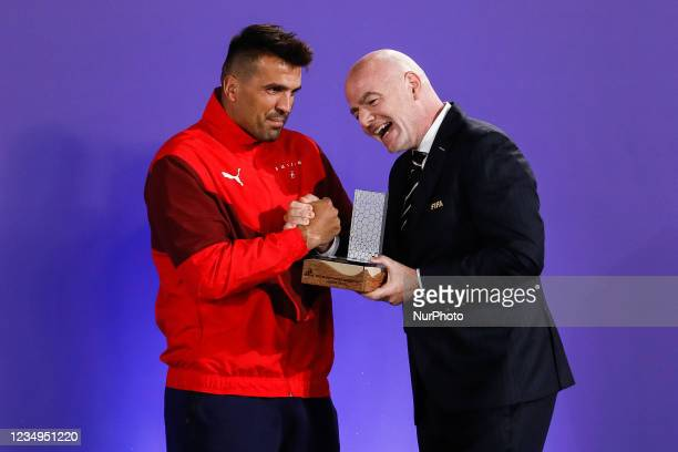 President Gianni Infantino presents Dejan Stankovic of Switzerland with his Silver Scorer Award during the prize-giving ceremony of the FIFA Beach...
