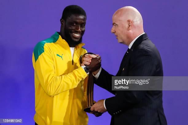 President Gianni Infantino presents Raoul Mendy of Senegal with his Bronze Ball award during the prize-giving ceremony of the FIFA Beach Soccer World...